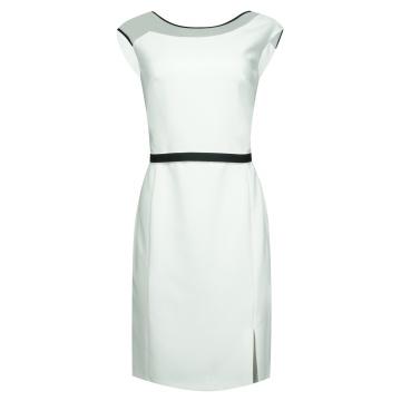 Biała dopasowana sukienka z...