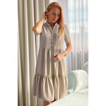 Beżowa sukienka z falbanami...