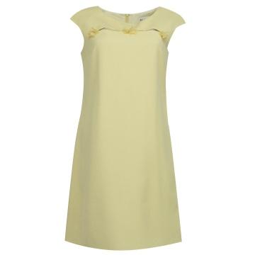 Żółta sukienka z kokardkami...