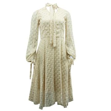 Beżowa sukienka w groszki,...