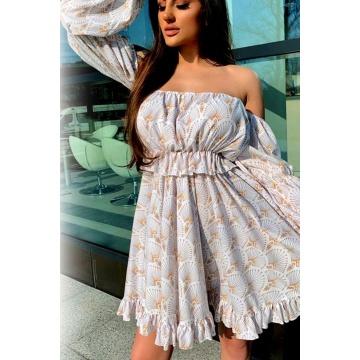 Kremowa zwiewna sukienka z...