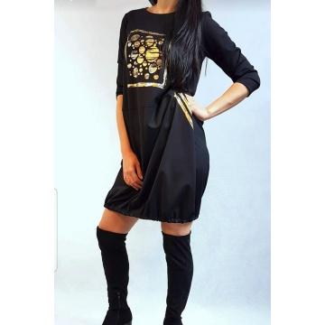 Czarna sukienka w złote...