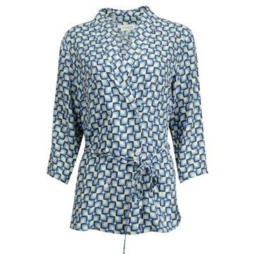 Niebieska bluzka damska we wzory geometryczne